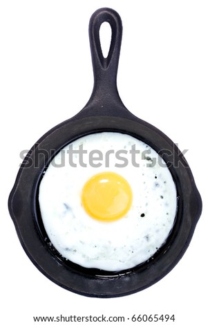 Fried Egg in a frying pan isolated on white, top view - stock photo