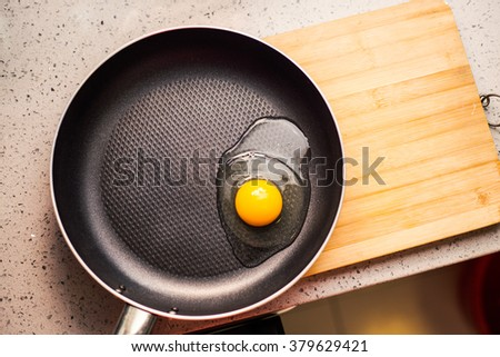 fried egg in a metal pan good photo - stock photo