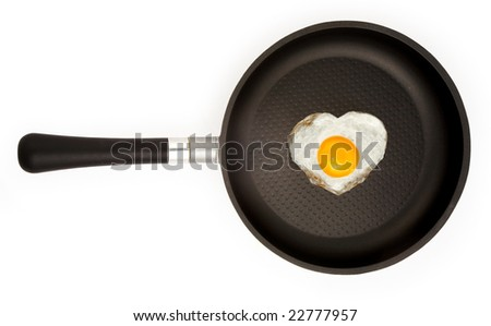 fried egg  in the heart's shape with clipping path