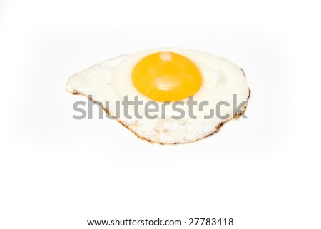 Fried egg isolated on a white studio background.