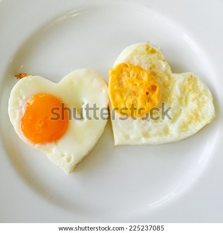 Fried egg on heart - stock photo