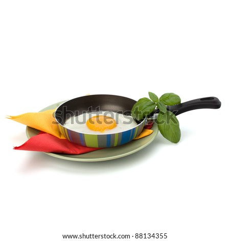 Fried egg on pan over white background - stock photo