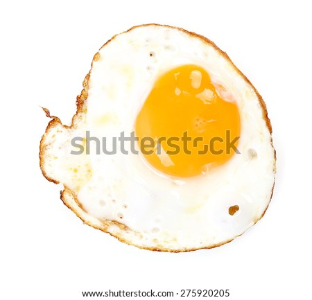 Fried egg on the table - stock photo