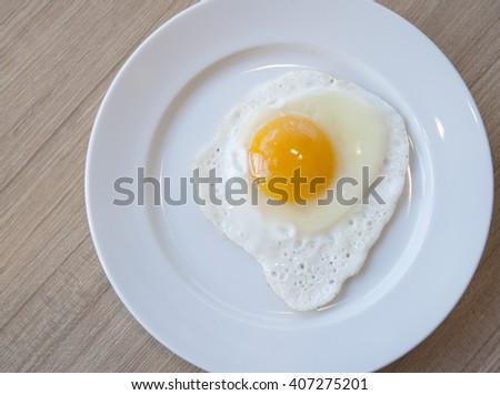 fried egg on white dish - stock photo