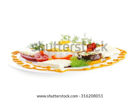 fried egg on white plate with vegetables - stock photo