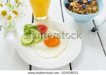 Fried egg, orange juice and muesli - stock photo