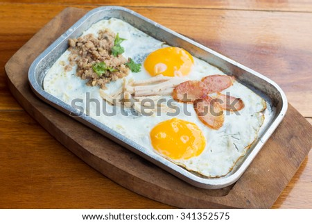 Fried egg pan with mince pork and garlic. - stock photo