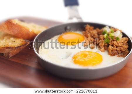 Fried egg pan with mince pork and garlic french toasted. - stock photo