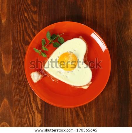 Fried Egg Sunny Side Up in Heart Shape - stock photo