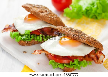 fried egg,tomato and bacon in wholemeal sandwich - stock photo