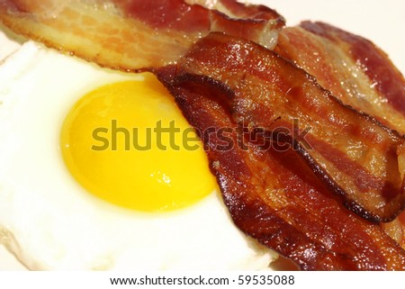 Fried egg with bacon breakfast - stock photo