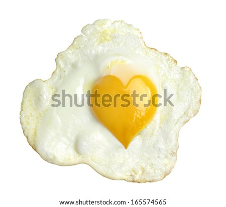 Fried egg with heart form yolk, isolated on white background - stock photo