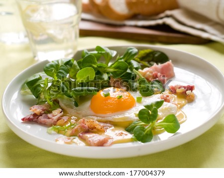 Fried egg with lettuce and bacon, selective focus