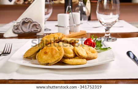 Fried eggplant on a white plate - stock photo