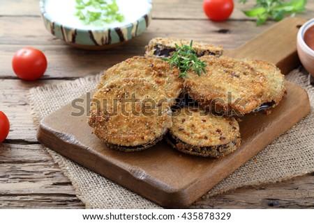 fried eggplant  on kitchen table background - stock photo