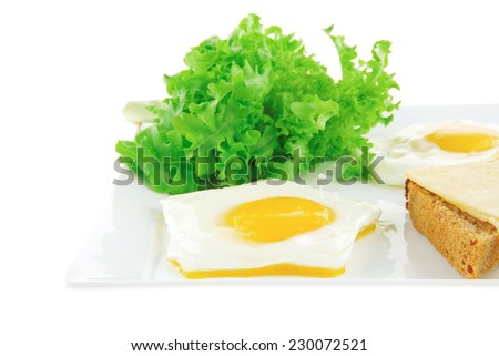 fried eggs and gold cheese on white plate - stock photo