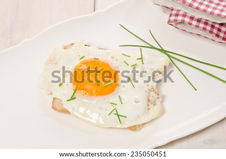 fried eggs as a small meal - stock photo