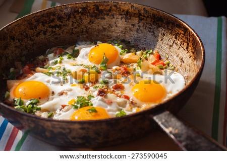 Fried eggs for breakfast - stock photo