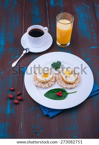 Fried eggs for breakfast. English breakfast. Morning coffee and juice. Wooden board rustic - stock photo