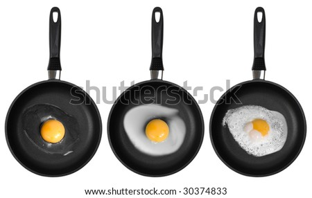 Fried eggs in the fry pan isolated on white. Clipping path - stock photo