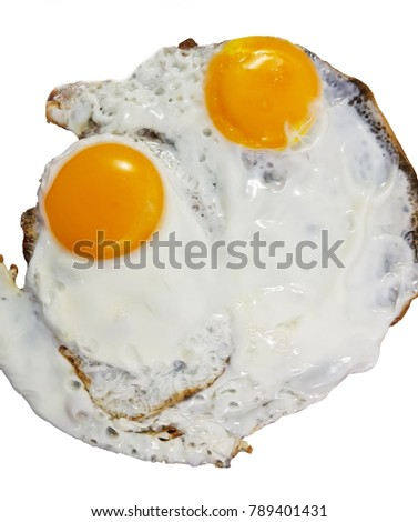 Fried eggs isolated white background, top view.