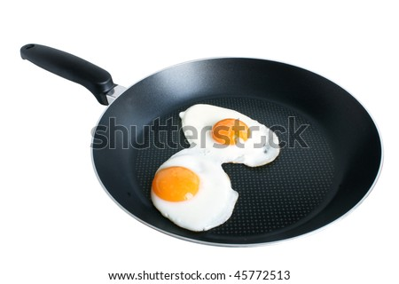 Fried eggs on griddle isolated on the white backgroun - stock photo