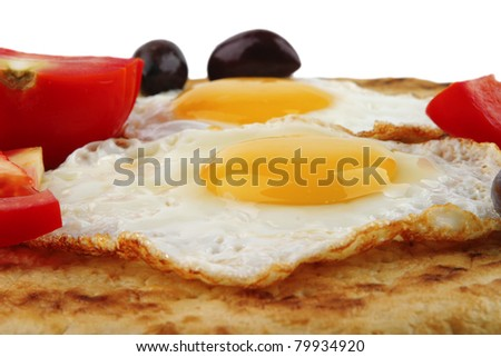 fried eggs on pancake over white background - stock photo