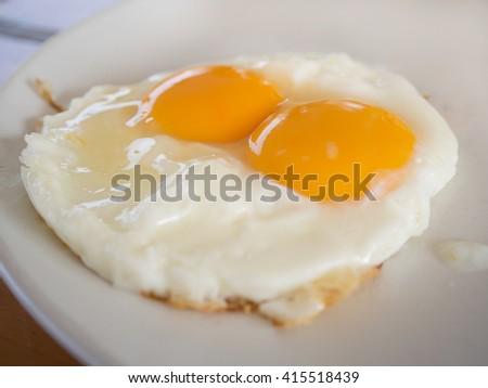 Fried eggs raw yolk in Breakfast  - stock photo