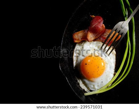 fried eggs with bacon and onions - stock photo