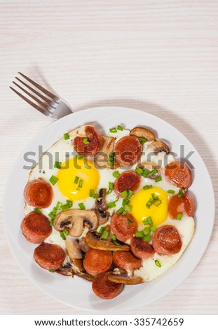 fried eggs with mushrooms and sausage
