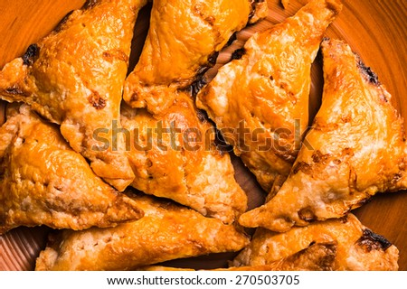 fried empanadas on basket - stock photo