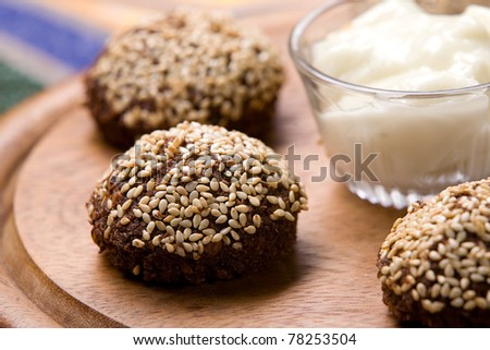 Fried falafel covered with sesame - stock photo