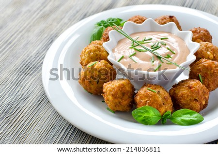 Fried falafels with a dip on wooden background - stock photo
