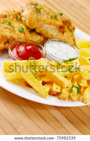Fried fish and chips on the white plate - stock photo