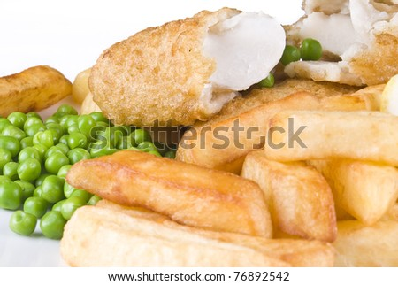 Fried fish and chips with lemon and peas - isolated - stock photo