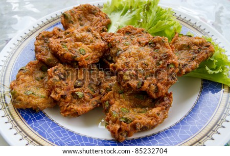 fried fish ball on plate - snack thai food - stock photo