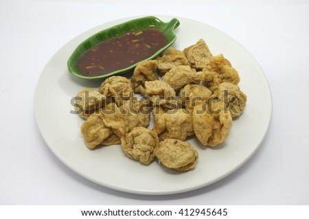 fried fish balls and spicy dip on white dish  - stock photo