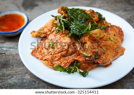 fried fish cake served with sweet sauce.
