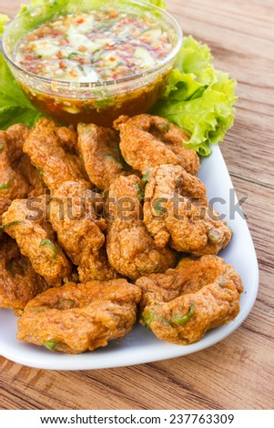 """Fried fish cakes with sweet chili sauce. Thai appetizer. Favorite food of thailand. Local name is """"Tod-Mun"""". - stock photo"""