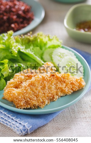 fried fish fillet serve with vegetable for clean eating,thai food