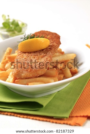 Fried fish fillet served with French fries - stock photo