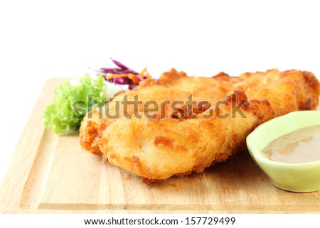 fried fish fillet with vegetables on white background - stock photo
