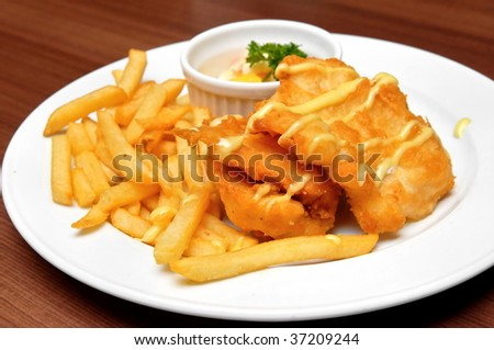 Fried fish fillets and french fries - stock photo