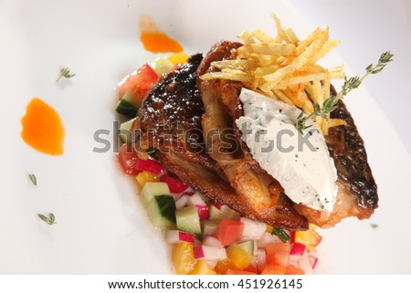 fried fish on vegetables on plate