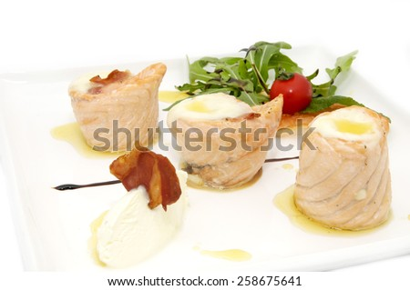 fried fish rolls with herbs on a white plate - stock photo