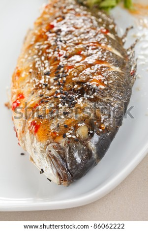 fried fish with fresh herbs and lemon - stock photo