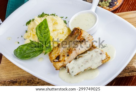 Fried fish with mashed potatoes - stock photo