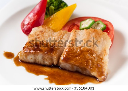 Fried fish with onion sauce - stock photo