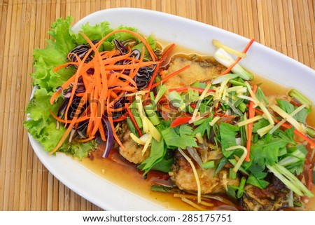 Fried fish with plum sauce - stock photo