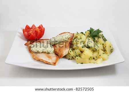 fried fish with potato on white plate isolated on white background - stock photo